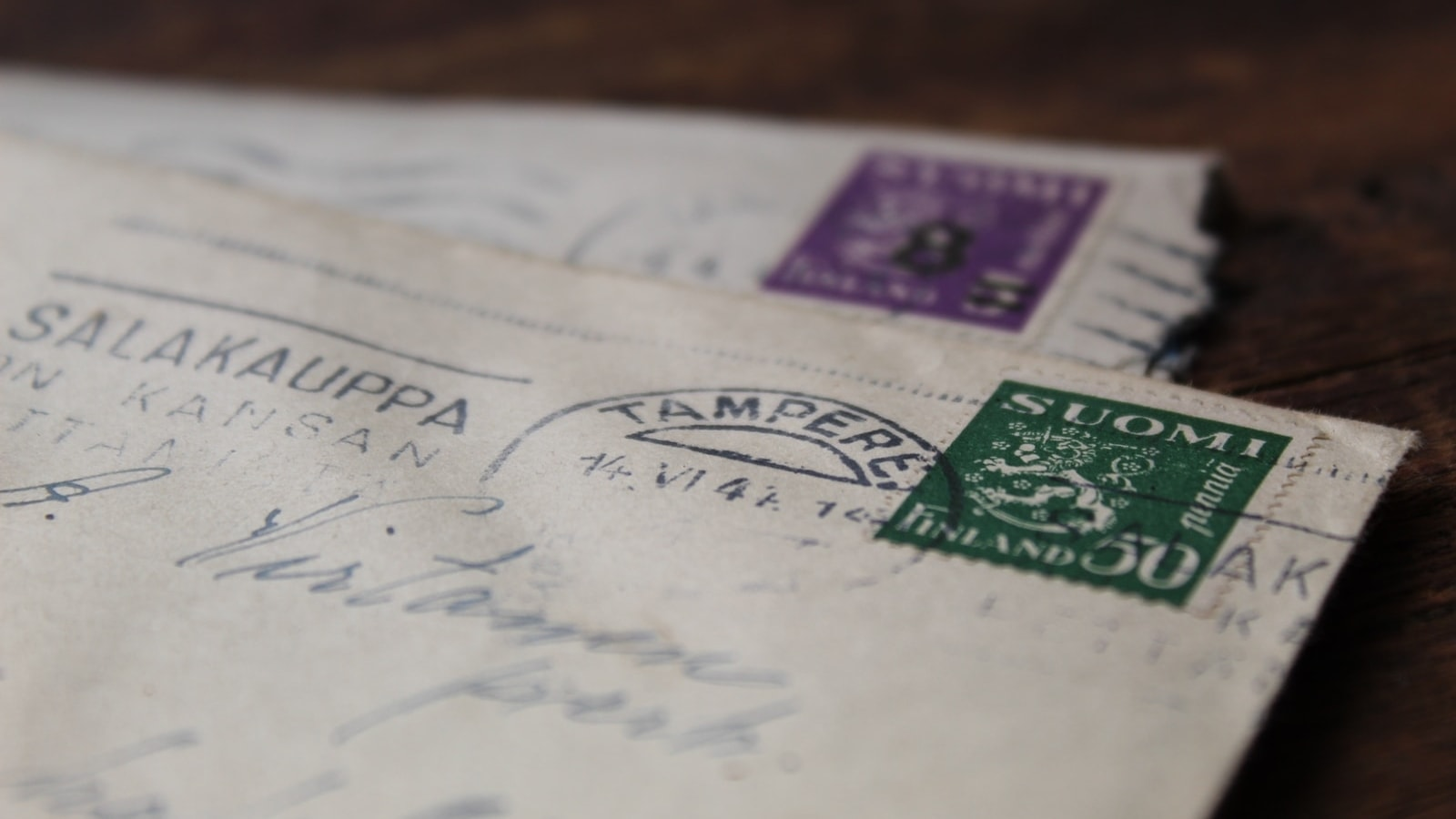 envelopes with postage stamps on a desk